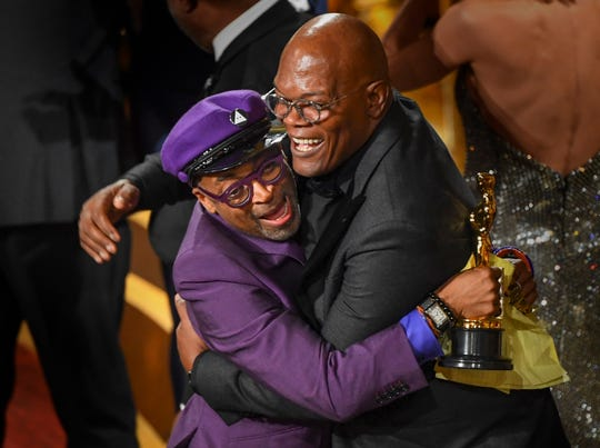 """BlacKkKlansman"" director Spike Lee, getting hugs from presenter Samuel L. Jackson as he took home his first Oscar at the 2019 Academy Awards, following five nominations in nearly 30 years."