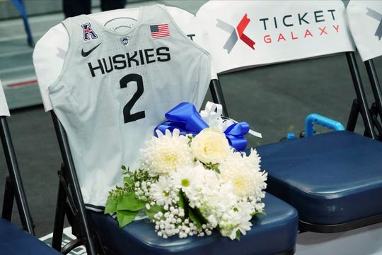 Flowers and UConn Huskies jersey is set on the UConn bench in honor of NBA star Kobe Bryant's daughter Gianna Bryant (not pictured) before the start of the game against the 2020 USA Womens National Basketball Team at XL Center on Monday.