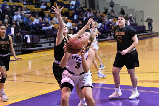 Hardin-Simmons' Parris Parmer (3) goes up for a shot around a Concordia defender. Parmer has started 17 of the 18 games this season as a freshman out of San Angelo Central