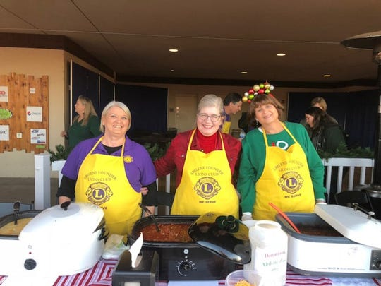 Participants in the Abilene Founders Lions Club's first Chili Bowl Cook-off at the Abilene Zoo's Christmas celebration. From left: Darla Flatt, third place; Elizabeth Norman, first place; and Susan Kilpatrick.