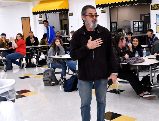 George Orosco, lead custodian at Abilene High School, is surprised in the cafeteria by Superintendent David Young and others Friday. Orosco was one of three in the district presented with the Impact Award, which recognizes employees who make exceptional efforts for making experiences on their campuses positive and memorable. Others honored Friday were Elaine Herwick, nurse at Taylor Elementary School, and Amber West, Bowie Elementary library assistant. They will be honored together at the Feb. 10 meeting of the AISD board of trustees.