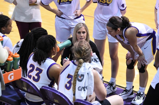 Hardin-Simmons coach Kendra Hassell talks to her team during a timeout against Concordia at the Mabee Complex on Thursday, Jan. 30, 2020. The Cowgirls won 57-54 to give Hassell 100 career wins as a head coach.