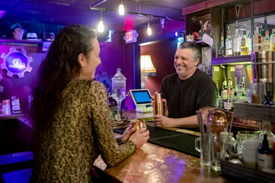 Whitney Diane and Jeff Catanese show off the Speakeasy bar at The Conundrum. The bar serves up prohibition era cocktails and more.