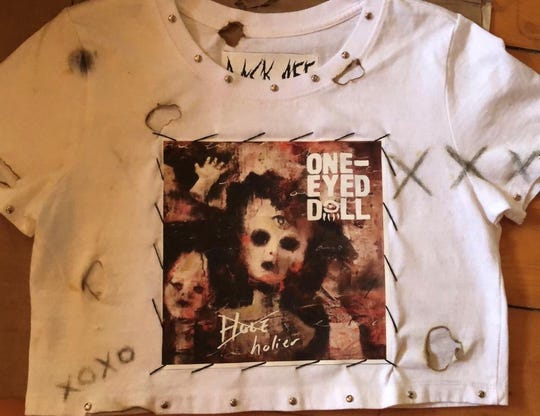 Lizzy Thomas, who designed and created this One-Eyed Doll t-shirt, lists fashion and clothing design as passions.