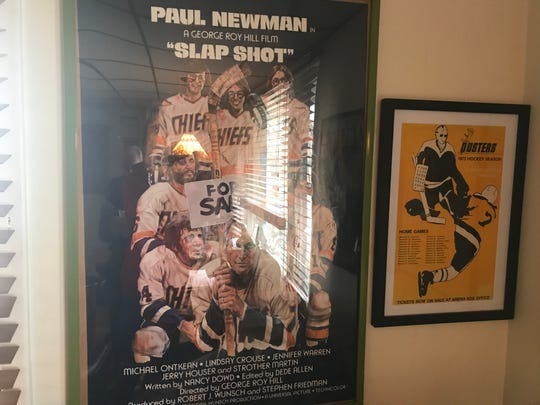 Frank Hamill's west-side Binghamton office includes a posters from Slap Shot and the Broome Dusters.