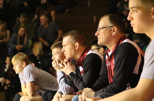 South Kitsap wrestling coach Chad Nass (center) watches the action during Thursday's match against Puyallup. Nass is 158-22 in 16 seasons with the Wolves.