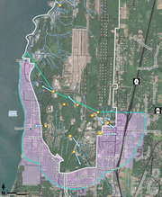 The purple highlights neighborhoods south, west and east of Bangor Navy officials believe could be in range for contaminants from a firefighting foam once used on base. The Navy says the yellow dots were confirmed sites the foam was use, and the arrows denote the direction of water flows in the area.