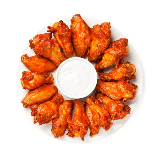 Hot wings consistently take top honors on Super Bowl snacking tables.