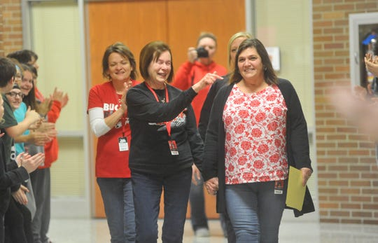 Norene Bard was escorted through the hallways on her final day at Bucyrus.
