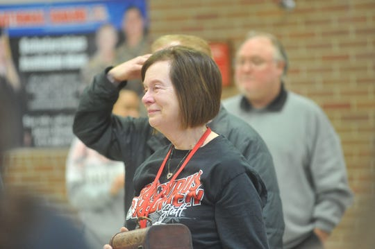 Norene Bard looks on as the Bucyrus XBand sent her off with the school fight song.
