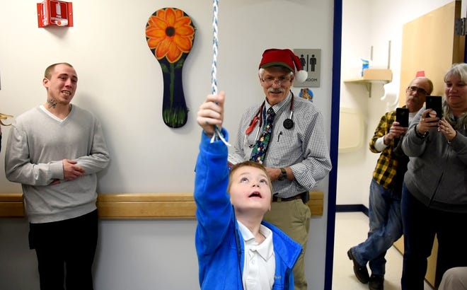 Spencer LaBonte rings the bell to mark the end of his leukemia treatment and the beginning of his remission during a special ceremony at the UVM Children's Hospital.