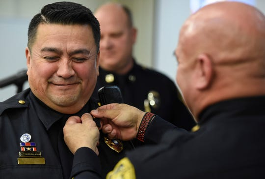 Capt. Frank Perez, left, makes a face while police Chief Mike Markle secures his captain pins during the Corpus Christi Police Department promotion ceremony, Friday, Jan. 31, 2020, at the Corpus Christi Police Department. Markle pinned all the promotions.