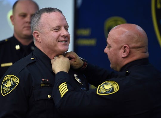 Lt. Christopher Meer receives his pins from police Chief Mike Markle during the Corpus Christi Police Department promotion ceremony, Friday, Jan. 31, 2020, at the Corpus Christi Police Department. Markle also pinned Meer's lieutenant badge.