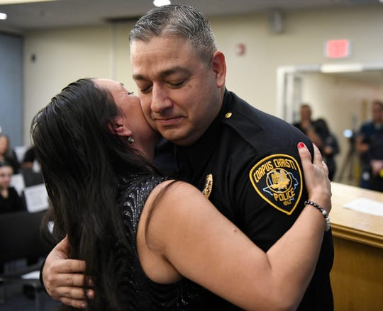 Gwendolynn Flores, left, embraces her husband, Adam, during the Corpus Christi Police Department officer promotion ceremony, Friday, Jan. 31, 2020, at the Corpus Christi Police Department. Adam was promoted to lieutenant.