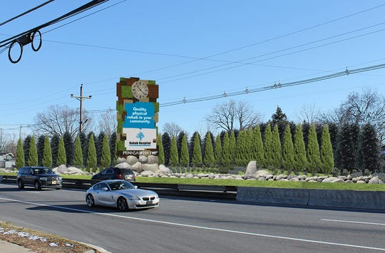 This modern clock tower sign is coming to Route 38 in Pennsauken this year to welcome visitors and display announcements and advertising on a highway property now occupied by a business building.