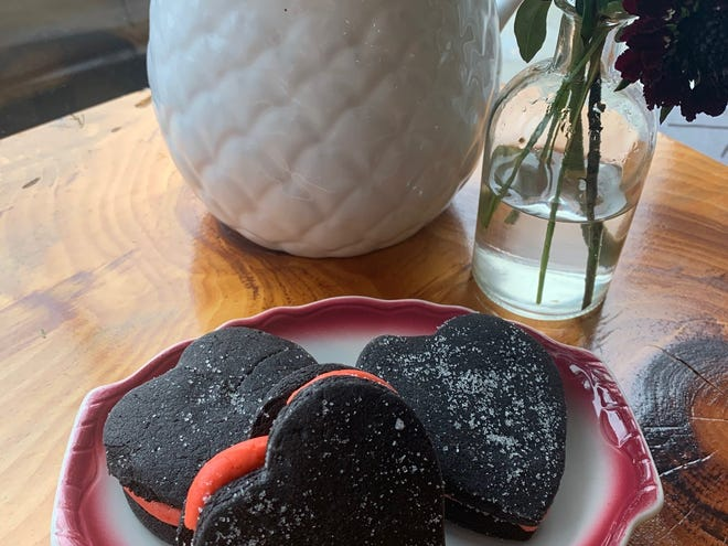 Vegan heart-shaped cookies in a window seat at Constellation Collective in Collingswood.