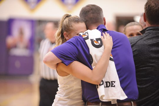 Unioto's Emily Coleman celebrates with her team on senior night during a 47-37 win over Southeastern on Thursday Jan. 30, 2020 as the Shermans clinched the outright SVC championship at Unioto High School in Chillicothe, Ohio.