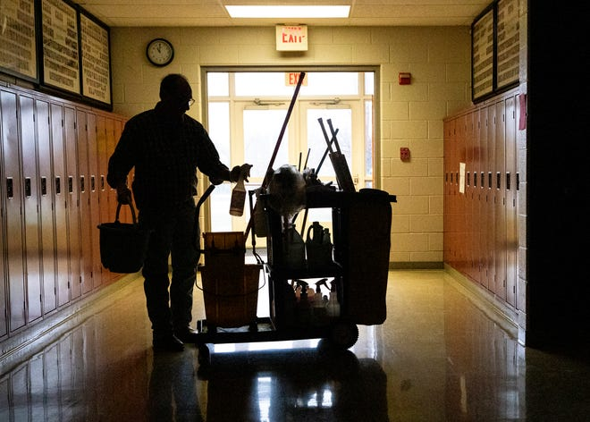 Zane Trace day shift janitor Rick Cottrill uses disinfectant spray and bleach in a bucket of water to kill anything that would cause students and faculty to get sick at Zane Trace High School on Jan. 30, 2020, in Chillicothe. He and his colleagues wiped down everything in the school touched by students - desks, light switches, walls, lockers, computers, etc.
