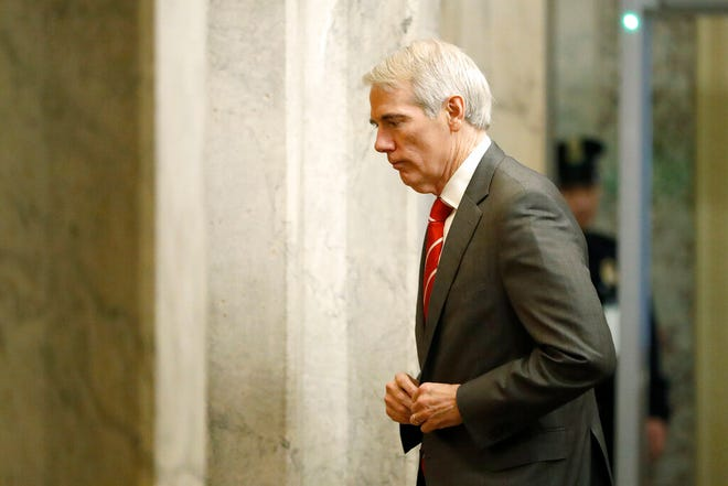 Sen. Rob Portman, R-Ohio, arrives at the Capitol in Washington during the impeachment trial of President Donald Trump on charges of abuse of power and obstruction of Congress, Thursday, Jan. 23, 2020. (AP Photo/Julio Cortez)