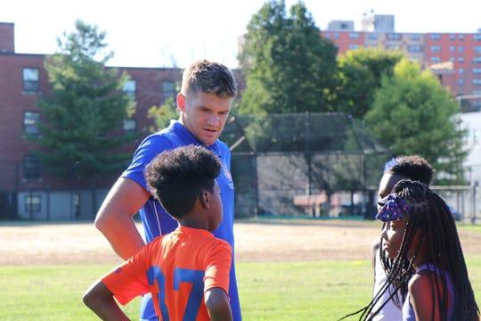 FC Cincinnati player Nick Hagglund talks to West End Pride player Arlando Griffin.