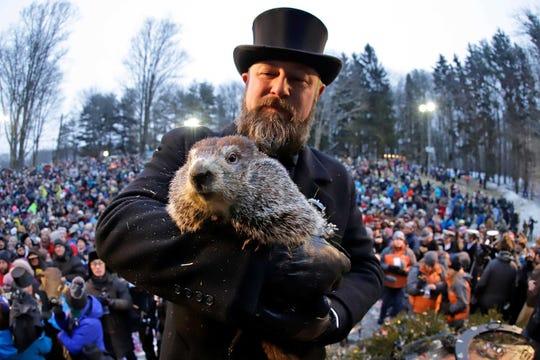 A file photo of Groundhog Club co-handler Al Dereume with Punxsutawney Phil.