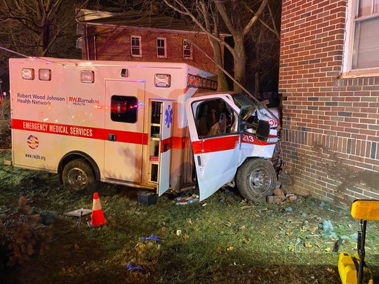 An ambulance crashed into a home on Hamilton Street Friday morning.