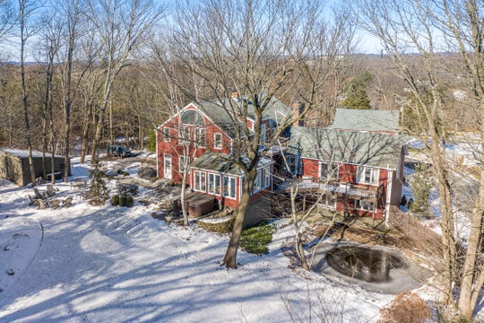 Aconverted circa 1835 barn filled fresh updates as well as rustic original features is for sale in Clinton Twp. for $699,900.