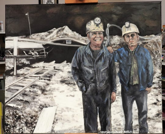 An oil painting by Carole Hunt depicts Sam Bennett as he is today with his father as he looked shortly before his death in 1971, in front of a mine once operated locally by the Simco-Peabody Coal Company.