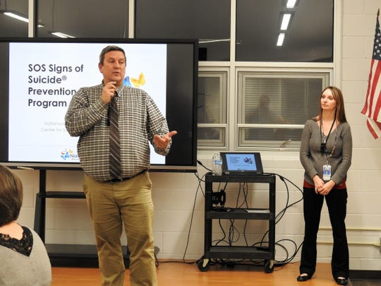 Superintendent Mike Masloski with Amberle Prater of Nationwide Children's Hospital addresses attendees at a presentation this past week at Ridgewood High School relating to the Signs of Suicide Prevention Program being introduced into the district.