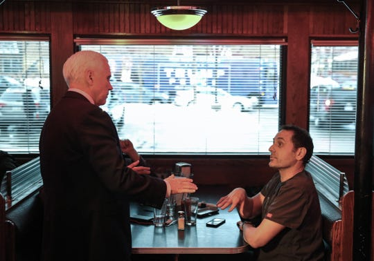 Vice President Mike Pence speaks with Dr. Rob Davidson about Medicare during a quick stop for food at Drake Diner on Thursday, Jan. 30, 2020, in Des Moines.