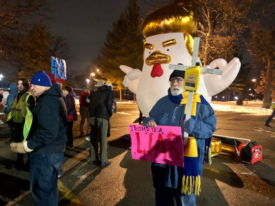 Frank Cordaro of Des Moines protests President Donald Trump's rally at Knapp Center on Drake University's campus.