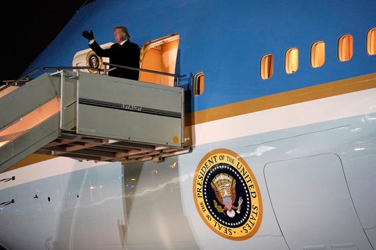 President Donald Trump waves as he arrives on Air Force One at Des Moines International Airport en route to speak at a campaign rally at the Knapp Center on the campus of Drake University.