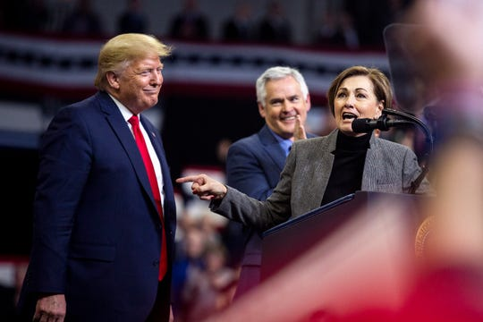 Iowa Governor Kim Reynolds talks about President Donald Trump after he called her up on stage during a campaign rally on Thursday, Jan. 30, 2020, at the Knapp Center in Des Moines.