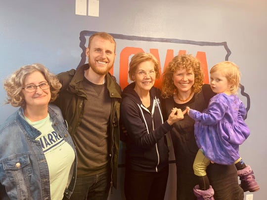 Colyn Burbank, center, Hilary Burbank and their daughter, Nell, pose with Sen. Elizabeth Warren during caucus season.