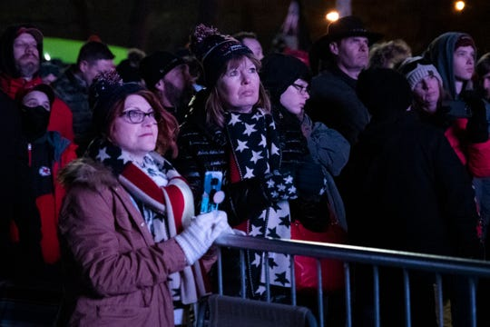 Supporters watch President Donald Trump's rally broadcasted outside the Knapp Center at Drake University. About 400 people couldn't get into the arena because it was at capacity.
