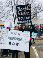 Taylor Vander Wall, left, and Hilary Burbank at a March 2018 gun rally in Des Moines.