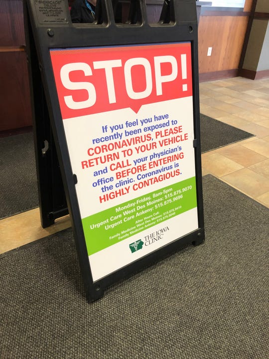 A sign at the Iowa Clinic in West Des Moines on Friday, Jan. 31, 2020, warns people who think they have the coronavirus from entering unless they have consulted with their doctor.