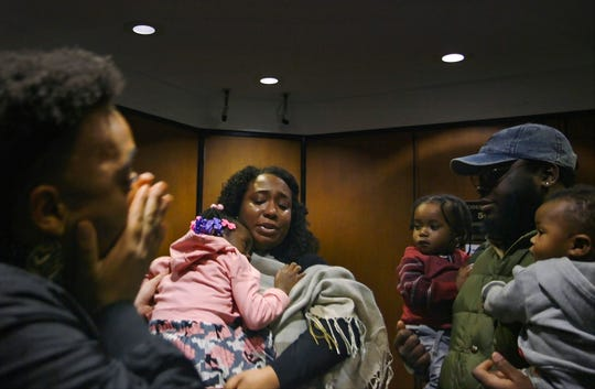 Siwatu-Salama Ra, 28, of Detroit, holds her daughter outside a courtroom at Frank Murphy Hall of Justice in Detroit, MI on Friday, January 31, 2020, surrounded by family, friends and supporters. Ra cut a deal with prosecutors and pleaded no contest to brandishing a firearm. In exchange, prosecutors dropped the felony firearm and assault charges stemming from a 2017 incident.