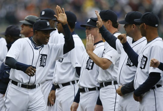 An injured Curtis Granderson greets his teammates during player introductions prior to the start of play  against the Kansas City Royals on Opening Day in 2008.