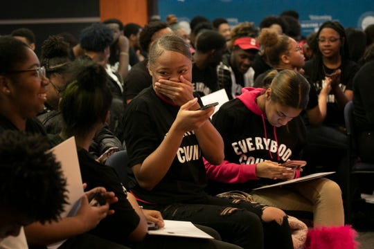 Cody high school seniors Airreona Godfrey, 17, laughs  with friends during a census rally that was held for hundreds of metro Detroit high school students at the Wayne County Community College in Detroit Friday, Jan. 31, 2020.