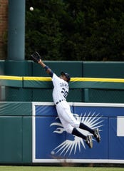 Detroit Tigers CF Curtis Granderson leaped over the wall to rob Boston Red Sox hitter Wily Mo Pena of a home run on July 8, 2007.