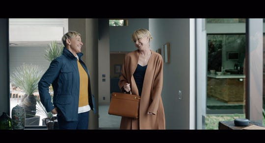 This undated image provided by Amazon shows Ellen DeGeneres, left, and her wife Portia De Rossi in a scene from the company's 2020 Super Bowl NFL football spot.