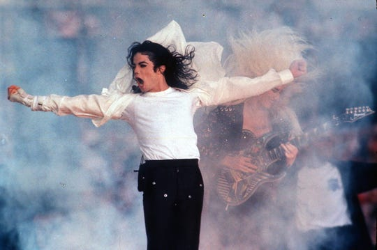 """Pop superstar Michael Jackson performs during the halftime show at the Super Bowl in Pasadena, Calif. in 1993. Regardless of your musical tastes, it seems the Super Bowl halftime show has gone there. From the sublime (Tony Bennett) to the ridiculous ( Janet Jackson's """"uncovering''), and from Michael Jackson's moonwalks to U2's majestic remembrance of the 911 victims, the halftime presentations have drawn nearly as much attention as the NFL championship game itself."""