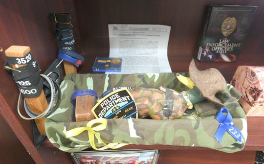 Potts keeps a basket of mourning bands and other items from police officers who have died in the line of duty that was given to her by former assistant chief Steve Dolunt when he retired.