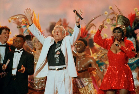 Singers Tony Bennett and Patti LaBelle entertain the crowd during halftime at Super Bowl XXIX at Miami's Joe Robbie Stadium.