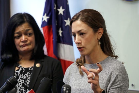 Rep. Pramila Jayapal, D-Wash., left, looks on as Negah Hekmati speaks about her hours-long delay returning to the U.S. from Canada with her family days earlier, at a news conference Monday, Jan. 6, 2020, in Seattle.