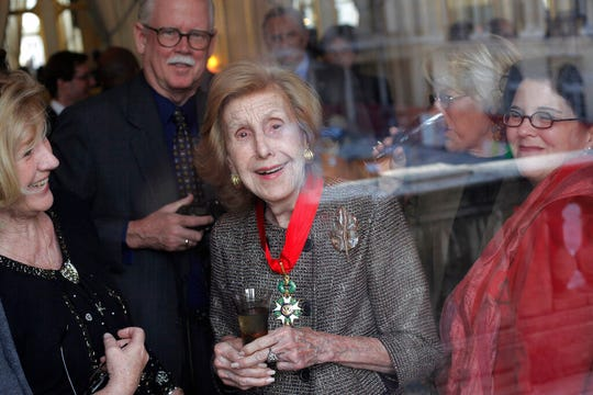 "In this Nov. 13, 2009 file photo, U.S billionaire media proprietor Anne Cox Chambers, center, smiles after being awarded ""Commandeur de la L'gion d'Honneur"" at the Culture Ministry, in Paris, Friday Nov. 13, 2009. The family of Anne Cox Chambers says the newspaper heiress has died. Her nephew, Jim Kennedy, announced her death to The Atlanta Journal-Constitution, her flagship newspaper."