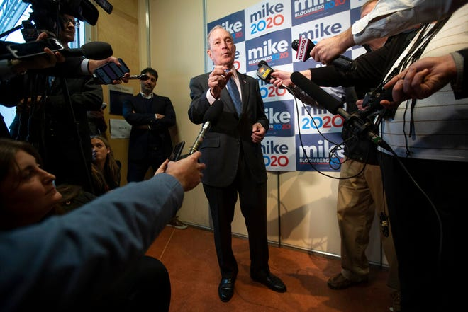 Democratic presidential candidate former New York City Mayor Michael Bloomberg speaks to reporters after a campaign event, Monday, Jan. 27, 2020, in Burlington, Vt.