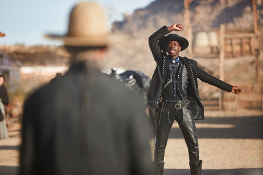 """This undated photo provided by Doritos shows Lil Nas X, right, and Sam Elliott in a scene from the company's 2020 Super Bowl NFL football spot. The snack chip is betting people will connect with """"Old Town Road,"""" the smash hit of the summer by Lil Nas X."""