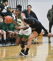 Cass Tech's Desiree Jackson gets fouled by King's Makiya Griffen who loses her footing in the first half.